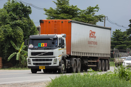 Chiangmai, Thailand - August 3 2018: Trailer Container Cargo Truck of STT Transport. Photo at road no.1001 about 8 km from city center, thailand.