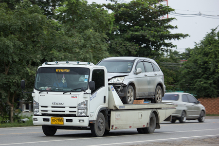 Chiangmai, Thailand - August  6 2018:  Private Tow truck for emergency car move. Photo at road no 121 about 8 km from downtown Chiangmai, thailand.