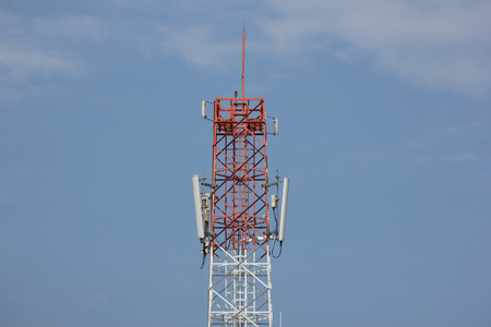 Mobile phone tower with airplane background