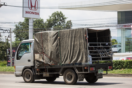 Chiangmai, Thailand - September 11 2018: Private  Isuzu  Cargo Truck. Photo at road no.1001 about 8 km from downtown Chiangmai, thailand.
