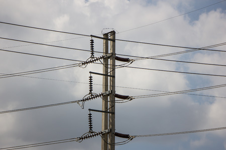 Closeup Eletricity line and electricity post wtih blue sky background Archivio Fotografico