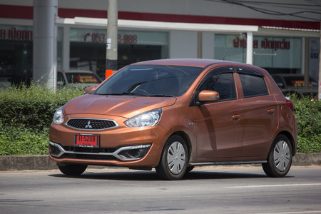 Chiangmai, Thailand - September 24 2018:  Private Eco car Mitsubishi Mirage. On road no.1001 8 km from Chiangmai Business Area. Redakční