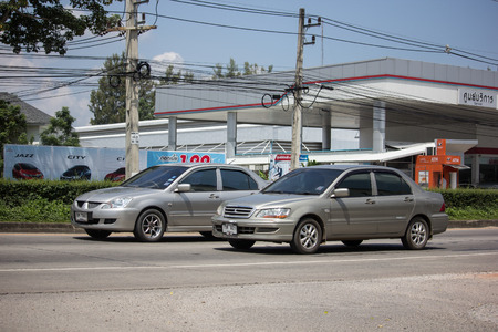 Chiangmai, Thailand - September 24 2018: Private car, Mitsubishi Lancer. Photo at road no 121 about 8 km from downtown Chiangmai, thailand.