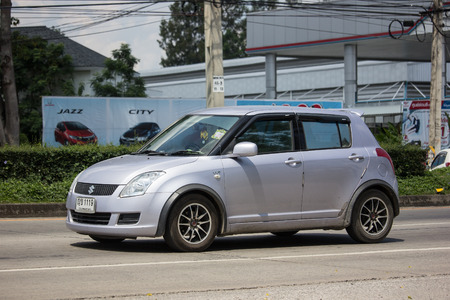 Chiangmai, Thailand - September 24 2018: Private Eco city Car Suzuki Swift. Photo at road no.121 about 8 km from downtown Chiangmai, thailand. Editorial