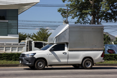 CHIANGMAI, THAILAND -APRIL 29 2016: C2C Transport Container Pickup truck.   Photo at road no 121 about 8 km from downtown Chiangmai, thailand.