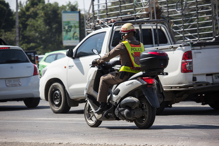 Chiangmai, Thailand - December 3 2018: Motorbike and  PoliceMan.   On road no.1001, 8 km from Chiangmai Business Area. Editorial