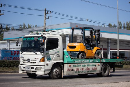 Chiangmai, Thailand - December 24 2018: Private Tow truck for emergency car move. Photo at road no 121 about 8 km from downtown Chiangmai, thailand.
