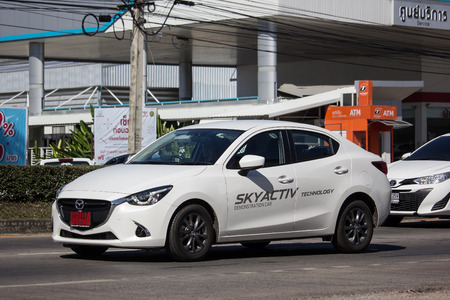 Chiangmai, Thailand - December 24 2018: Private Eco car Mazda 2. On road no.1001 8 km from Chiangmai Business Area.