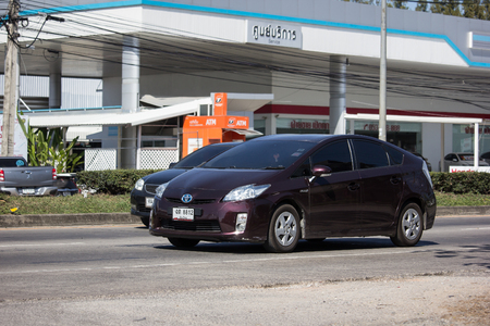 Chiangmai, Thailand - January 16 2019:  Private car Toyota Prius Hybrid System. On road no.1001 8 km from Chiangmai Business Area.