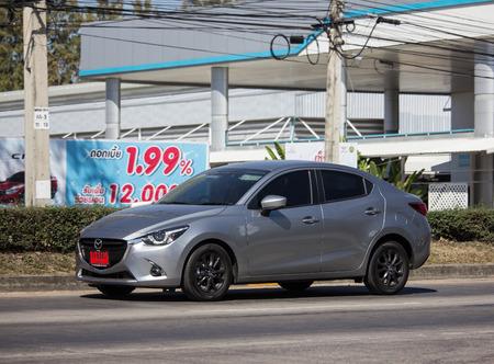 Chiangmai, Thailand - February 4 2019: Private Eco car Mazda 2. On road no.1001 8 km from Chiangmai Business Area.