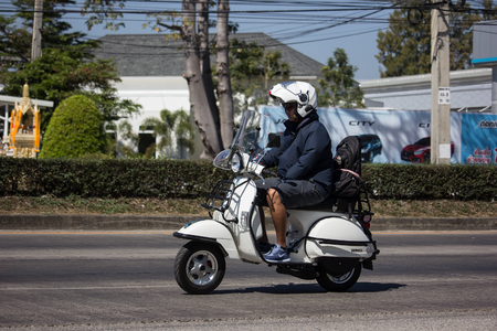 Chiangmai, Thailand - February 4 2019: Private Scooter Motorcycle Vespa. Photo at road no.121 about 8 km from downtown Chiangmai, thailand.