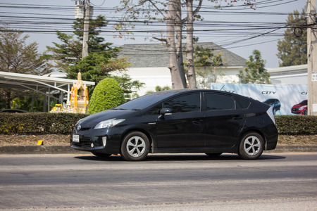Chiangmai, Thailand - February 11 2019: Private car Toyota Prius Hybrid System. On road no.1001 8 km from Chiangmai Business Area.
