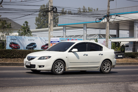Chiangmai, Thailand - February 18 2019:  Private City Car, Mazda 3. Photo at road no 121 about 8 km from downtown Chiangmai, thailand.