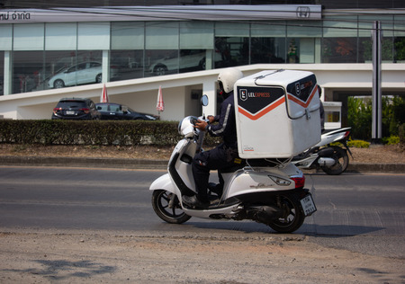 Chiangmai, Thailand - February 26 2019: Lazada Express and Logistics Mini Container Motorcycle. Photo at road no 121 about 8 km from downtown Chiangmai, thailand.