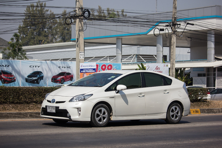 Chiangmai, Thailand - February 25 2019: Private car Toyota Prius Hybrid System. On road no.1001 8 km from Chiangmai Business Area.