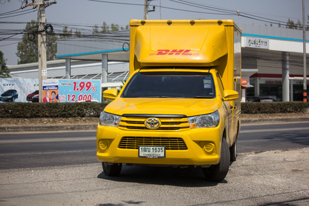 Chiangmai, Thailand - March 4 2019: DHL Express and Logistics Container Pickup truck. Modify from Toyota Hilux Revo. Photo at road no 121 about 8 km from downtown Chiangmai, thailand.