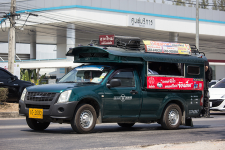 Chiangmai, Thailand - March 8 2019: Green Pickup truck taxi Chiangmai, Isuzu Pickup truck.  On road no.1001, 8 km from Chiangmai Business Area.