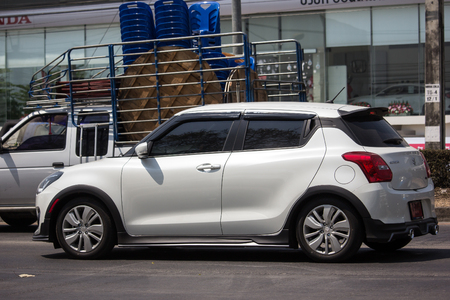 Chiangmai, Thailand - March 8 2019:  Private Eco city Car New Suzuki Swift. Photo at road no.121 about 8 km from downtown Chiangmai, thailand.