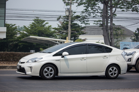 Chiangmai, Thailand - April 4 2019:  Private car Toyota Prius Hybrid System. On road no.1001 8 km from Chiangmai Business Area.