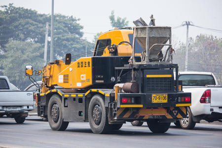 Chiangmai, Thailand - April 5 2019: KATO Crane MR-100 of ST Construction Company.Photo at road no 121 about 8 km from downtown Chiangmai, thailand.