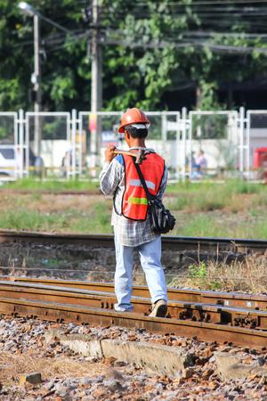 Chiangmai, Thailand - September 18 2012: Maintenance railway Man Walk for Track Check. Photo at Chiangmai railway station.