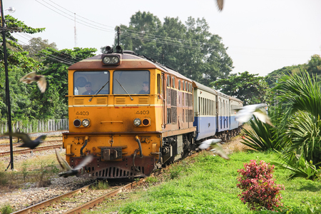 Chiangmai, Thailand - October 10 2012: Bird and Alsthom locomotive no.4403 for train no.51 from Bangkok to Chiangmai. Zdjęcie Seryjne - 122360895