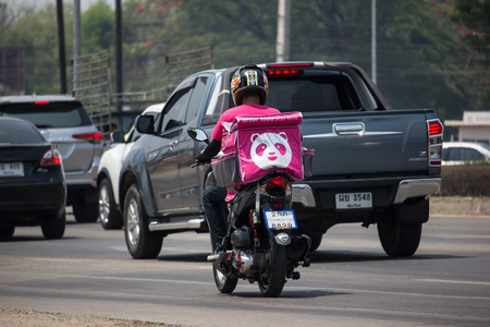 Chiangmai, Thailand - April 30 2019: Delivery service man ride a Motercycle of Food Panda. On road no.1001, 8 km from Chiangmai city. Editorial