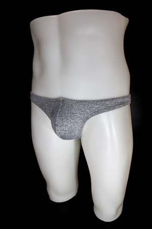 Thong Sexy T-Back Underwear on mannequin male on black background 写真素材 - 123737241