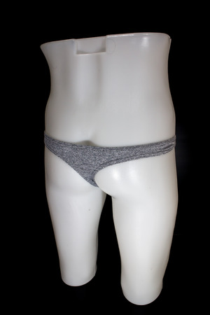Thong Sexy T-Back Underwear on mannequin male on black background 写真素材 - 123737243