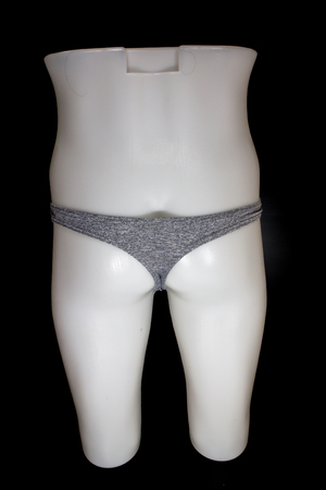 Thong Sexy T-Back Underwear on mannequin male on black background 写真素材 - 123737391