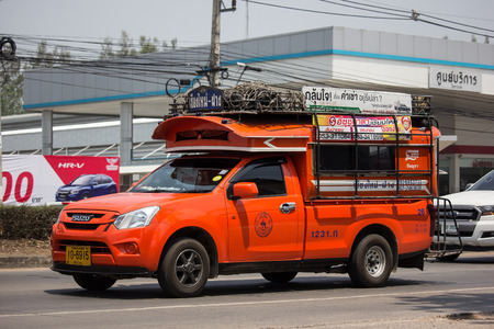 Chiangmai, Thailand - April 26 2019: Orange Pickup truck taxi Chiangmai to Fang.  On road no.1001, 8 km from Chiangmai Business Area. Sajtókép