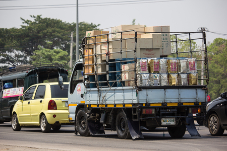 Chiangmai, Thailand - April 30 2019: Private Isuzu  Cargo Truck. Photo at road no.1001 about 8 km from downtown Chiangmai, thailand. Редакционное