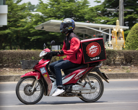 Chiangmai, Thailand - April 30 2019: Delivery service man ride a Motercycle of Pizza Hut Company. On road no.1001, 8 km from Chiangmai city. Editorial