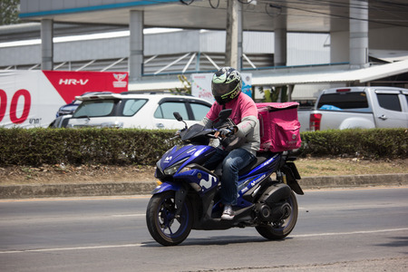 Chiangmai, Thailand - May 17 2019: Delivery service man ride a Motercycle of Food Panda. On road no.1001, 8 km from Chiangmai city.
