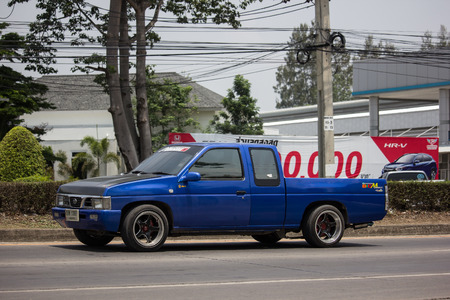 Chiangmai, Thailand - May 17 2019:  Private Pickup car, Nissan Big M. On road no.1001, 8 km from Chiangmai Business Area.