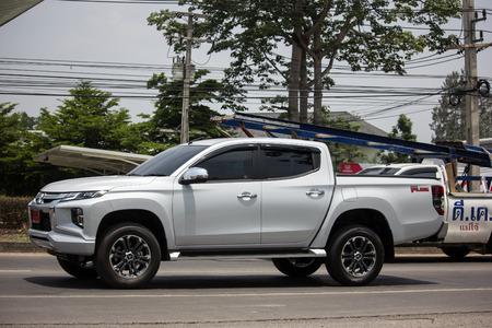 Chiangmai, Thailand - May 17 2019:  Private car, New Mitsubishi Triton Pickup Truck. On road no.1001, 8 km from Chiangmai Business Area.