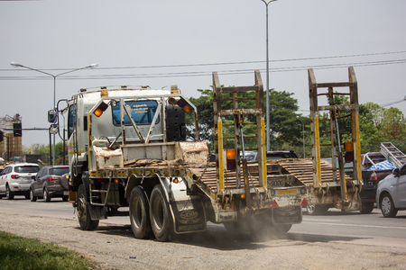 Chiangmai, Thailand - May 23 2019: Trailer Dump Truck and Backhoe  of Payawan Transport Company. Photo at road no.121 about 8 km from downtown Chiangmai, thailand.