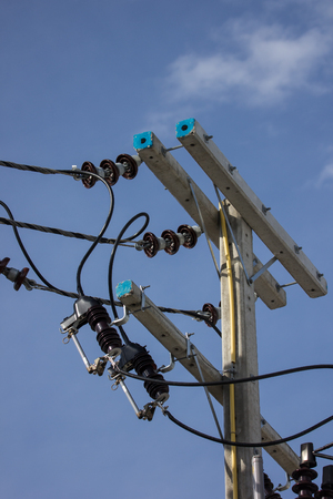 Closeup Eletricity line and electricity post wtih blue sky background Imagens
