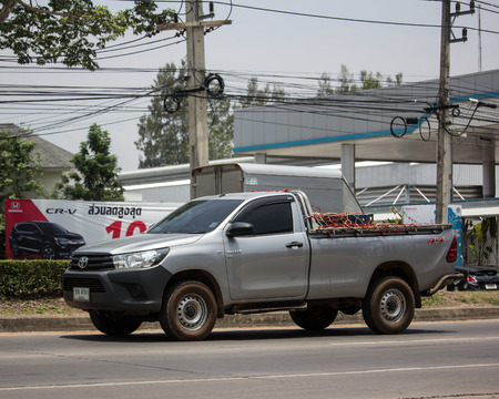 Chiangmai, Thailand - May 23 2019: Private Pickup Truck Car Toyota Hilux Revo. On road no.1001, 8 km from Chiangmai city. Editorial
