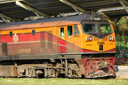 Chiangmai, Thailand - December 26 2012: GE Diesel Locomotive NO 4559. For Train no.52 to Bangkok from Chiangmai. Photo at Chiangmai railway station. Publikacyjne