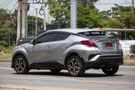 Chiangmai, Thailand - May 23 2019: New Toyota CHR Subcompact Crossover SUV Hybrid Car. Car on road No.121 to Chiangmai City. Редакционное