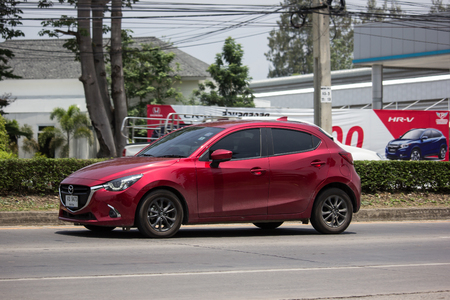 Chiangmai, Thailand - May 23 2019: Private Eco car Mazda 2. On road no.1001 8 km from Chiangmai Business Area.