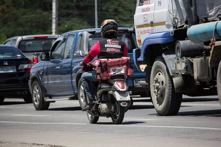 Chiangmai, Thailand - June 4 2019: Delivery service man ride a Motercycle of KFC. On road no.1001, 8 km from Chiangmai city. Editorial