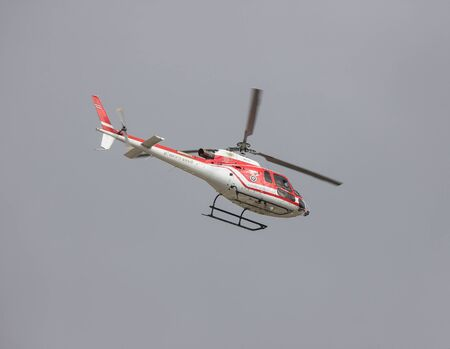 Chiangmai, Thailand - July 15 2019: Eurocopter AS 350B2 Ecureuil of Ministry of Natural Resources and Environment. Fly Over chiangmai Sky.