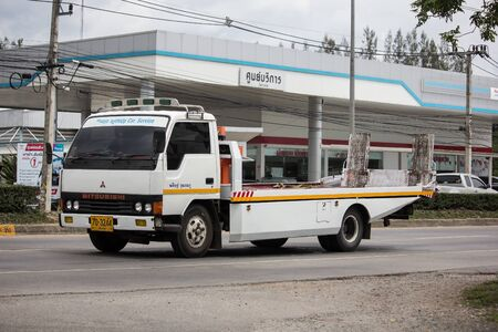 Chiangmai, Thailand - July 11 2019:  Private Tow truck for emergency car move. Photo at road no 121 about 8 km from downtown Chiangmai, thailand.