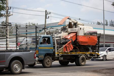 Chiangmai, Thailand - July 15 2019: Kubota Combine Harvesters on truck. Photo at road to city. Editorial