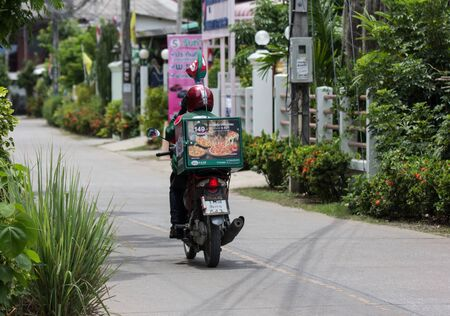 Chiangmai, Thailand - July 21 2019: Delivery service man ride a Motercycle of The Pizza Company. On road no.1001, 8 km from Chiangmai city.