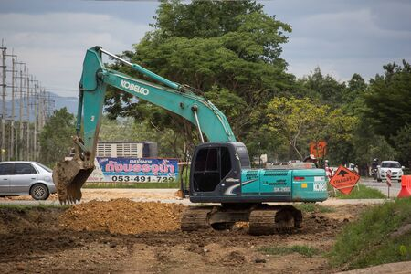 Chiangmai, Thailand - August 2 2019:  Private Kobelco backhoe on Construction road. On road no.1001, 8 km from Chiangmai city.