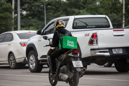 Chiangmai, Thailand - August 9 2019: Delivery service man ride a Motercycle of Grab Food. On road no.1001, 8 km from Chiangmai city. Editorial