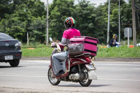 Chiangmai, Thailand - August 29 2019: Delivery service man ride a Motercycle of Food Panda. On road no.1001, 8 km from Chiangmai city.